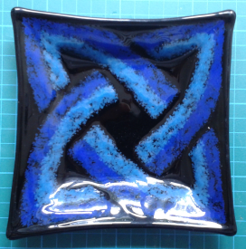 Blue Square Knot, 14cm x 14cm. Two colours of blue frit arranged on a single layer of black glass.