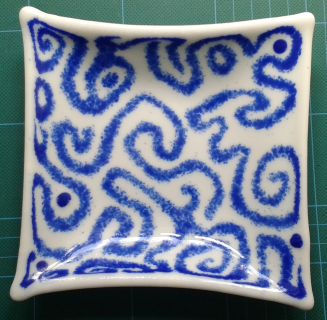 Blue Swirl. 14cm x 14cm. Cobalt blue frit arranged on a single layer of white glass.