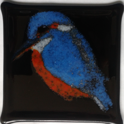 Kingfisher. This used a blue glass which turns metallic in the presence of air in the kiln. It can be seen between his wings and on his beak.